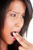 pic of vomit  - Woman putting her finger in her mouth to provoke vomiting isolated on white background - JPG