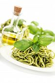 image of pesto sauce  - delicious italian pasta with pesto sauce over white - JPG