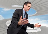image of spiral staircase  - Businessman posing with arms out against spiral staircase in the sky - JPG