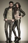 pic of pulling hair  - in love couple dressed in leather clothes in a fashion pose in studio - JPG