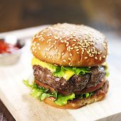 picture of burger  - burger with sesame bun and melted cheese close up - JPG