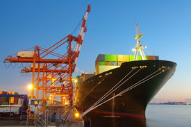 picture of shipyard  - Container Cargo freight ship with working crane bridge in shipyard - JPG