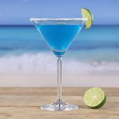 picture of curacao  - Blue Curacao cocktail drink on the beach and sea - JPG