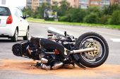 stock photo of armored car  - motorbike accident on the city road in europe - JPG