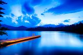 picture of dock a pond  - lake santeetlah blue hour in great smoky mountains