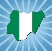 foto of nigeria  - Nigeria map flag on blue sunburst illustration - JPG