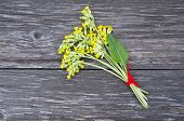 stock photo of cowslip  - Common Cowslip Primrosa( Primula veris) medical flowers bunch on old wooden board