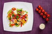 foto of gyro  - Chicken gyros salad on white plate top view - JPG
