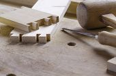 stock photo of workbench  - Detail of a dovetail joint before assembling parts - JPG
