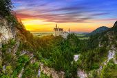 pic of bavarian alps  - Neuschwanstein Castle in the Bavarian Alps at sunset - JPG