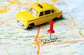 pic of ferrara  - Close up of Ferrara Italy map with red pin and a taxi - Travel concept