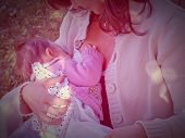 picture of breastfeeding  - Pretty young brunette mum breastfeeding her baby - JPG