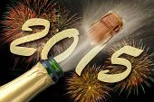 pic of sparkling wine  - popping Champagne and firework for new year 2015 - JPG