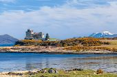 image of castle  - Duart Castle is a castle on the Isle of Mull off the west coast of Scotland within the council area of Argyll and Bute - JPG