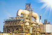 image of refinery  - Machinery in Oil refinery plant with blue sky background - JPG