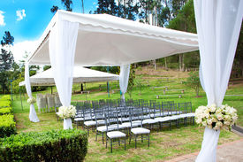 stock photo of canopy roof  - a wedding marquee with bouquets of roses - JPG
