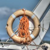 stock photo of life-boat  - life buoy on a boat side - JPG