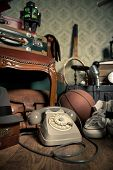 pic of attic  - Group of vintage objects on attic hardwood floor including old toys phone and sports items - JPG