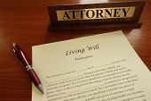 image of deceased  - A living will document with pen and attorney name plate - JPG