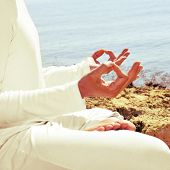 foto of padmasana  - someone meditating in front of the sea - JPG