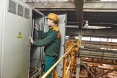 foto of fuse-box  - electrician builder engineer switching actuator equipment in distribution fuse box at factory - JPG
