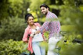 picture of tandem bicycle  - Young couple riding on the bicycle in the park - JPG