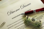 stock photo of divorce-papers  - Divorce papers and cash with misc items - JPG