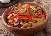 stock photo of sauteed  - Sauteed mushrooms with pumpkin and sweet pepper - JPG