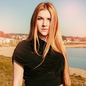foto of gothic girl  - unusual gothic girl with long red hair reflects at the lake - JPG