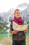 foto of south tyrol  - Young woman with map on lake braies in south tyrol italy - JPG