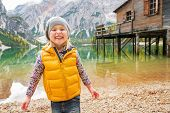 pic of south tyrol  - Portrait of smiling child on lake braies in south tyrol italy - JPG