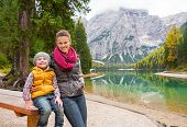 foto of south tyrol  - Portrait of happy mother and baby on lake braies in south tyrol italy - JPG