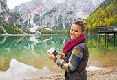 picture of south tyrol  - Happy young woman with tablet pc on lake braies in south tyrol italy - JPG