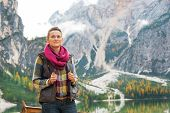 foto of south tyrol  - Young woman on lake braies in south tyrol italy - JPG