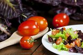 stock photo of chicory  - Mixed salad with red chicory and tomato - JPG