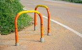 stock photo of bollard  - colorful parking bollards on the edge of the road - JPG