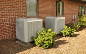 stock photo of air conditioning  - Outdoor air conditioning unit for a small office building - JPG
