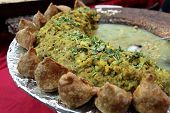 foto of samosa  - Pan with samosa potato and pea curry in the indian restaurant - JPG