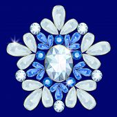 foto of brooch  - Brooch with diamonds and sapphires on a blue background - JPG