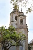 image of faro  - Belltowers of Santo Antonio Church a National Monument in Faro Algarve Portugal with trees surrounding - JPG