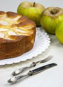image of pie-in-face  - Homemade italian baked apple pie over a white table - JPG