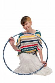 foto of hulahoop  - Young beautiful woman with a hula hoop - JPG