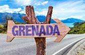 Постер, плакат: Grenada wooden sign with road background