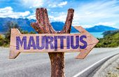 stock photo of mauritius  - Mauritius wooden sign with road background - JPG