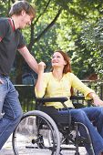 picture of rollator  - boy is talking to his girlfriend on a wheelchair - JPG