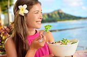 image of waikiki  - Salad eating healthy woman at restaurant in Hawaii - JPG
