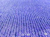 stock photo of violets  - Violet sequins embroidered on black fabric with soft focus - JPG