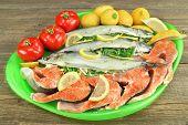 pic of redfish  - Large Dish With Fresh Stuffed Fish Salmon Steaks Lemon Slice And Herbs - JPG