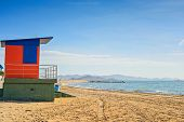 pic of beach-house  - Red and blue lifeguard house on the sandy beach - JPG