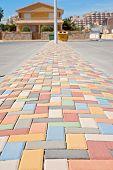 stock photo of paving stone  - Multi colored vibrant paving stones on the street - JPG